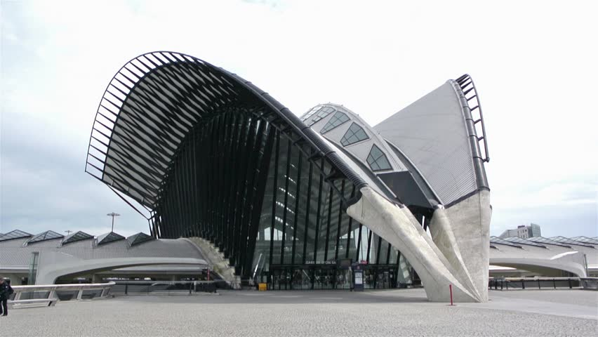 LYON, FRANCE - May 10, 2014: Modern and aerodynamic building of Gare de Saint-Exupery TGV, tilt up view on May 11. Saint-Exupery station was designed by Santiago Calatrava, cost 750 million Francs