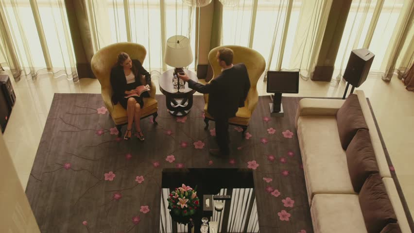 Business people, man and woman working in hotel suite room, husband, wife in luxury home, wealthy life, manager, businessman, businesswoman talking on mobile telephone, cell phone, reading book. 1of21 | Shutterstock HD Video #6371675