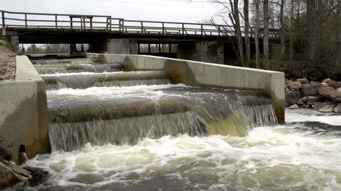 A fish ladder that looks like a dam with rushing water