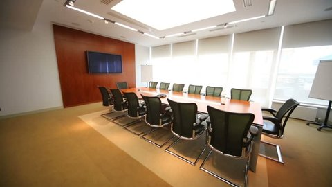 Turning off lights in stylish room for business meetings