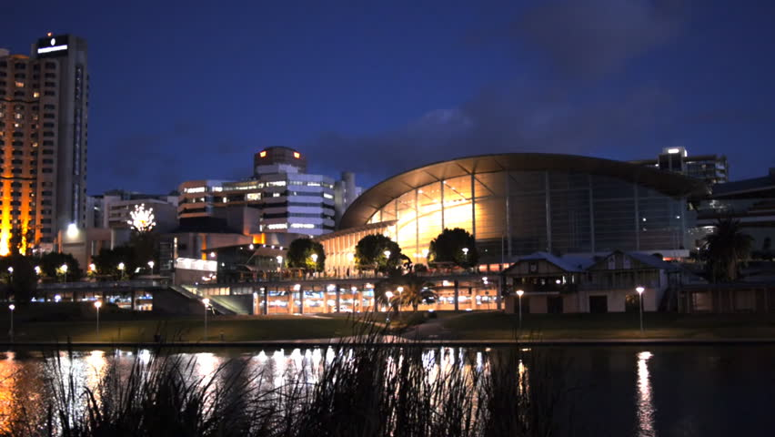 ADELAIDE, AUSTRALIA - APRIL 14: a night view of the river torrens and the convention center in adelaide