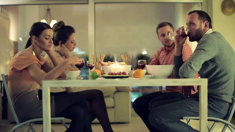Unhappy, bored friends sitting by the table on bad double date