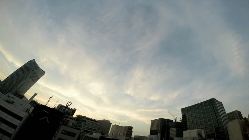 Timelapse view of the sky over the busy megalopolis Tokyo. #6491579