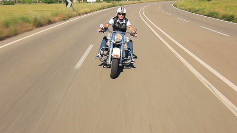 reggello,1/05/2014 motorbike festival,man riding his harley davidson on a highway follow shot car point of view