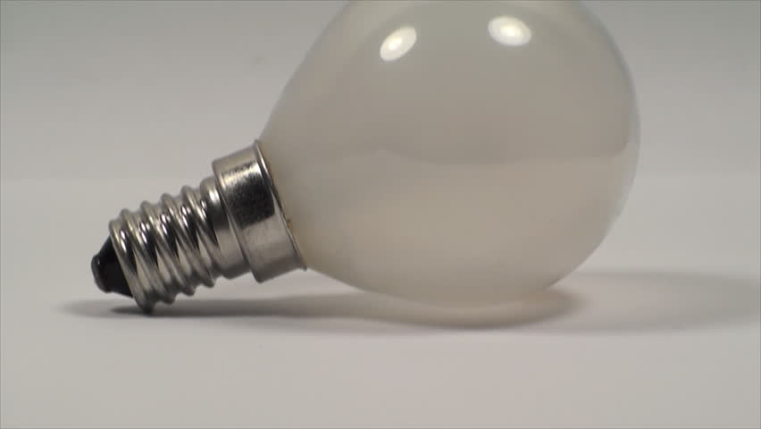 Economic Light Bulb On A White Background, Power, Light, Eco, Friendly, Pan | Shutterstock HD Video #6545345