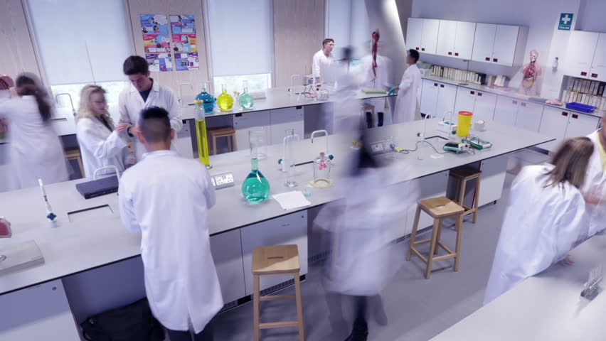 Time lapse group of students working in science class in modern university