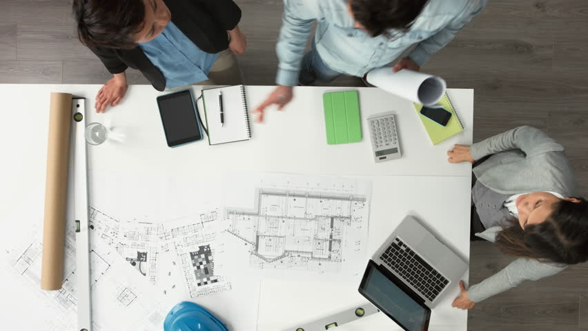 Architect plans arial view business meeting showing teamwork young diverse startup   Shutterstock HD Video #6554477
