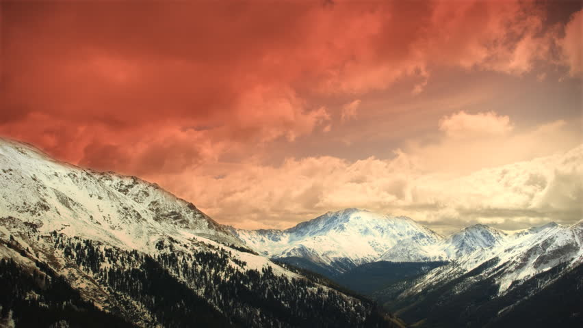 (1151) Early Early Winter Mountains Snow Sunset Clouds Skiing. Great for themes of skiing, winter sports, adventure, mountains, nature, weather, tourism, travel. Excellent loop for nature composites.