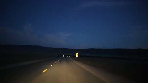 POV driving on remote night road in Southern California