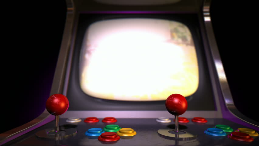 a pan across of a vintage arcade game with a joystick and a green screened monitor on an. Black Bedroom Furniture Sets. Home Design Ideas