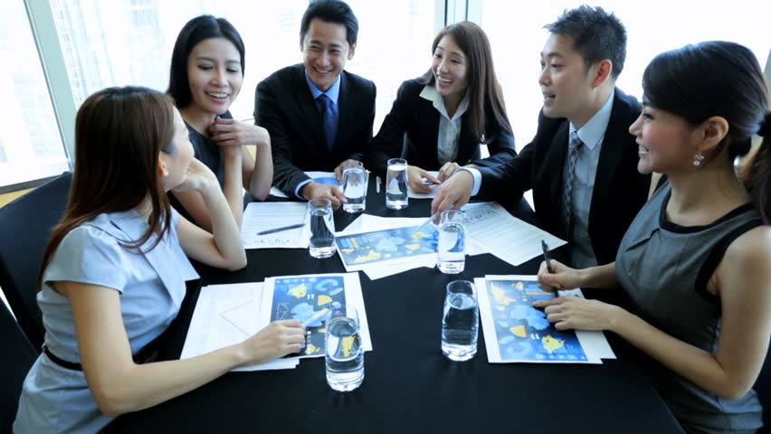 Smart successful team Asian Chinese banking executives meeting city boardroom discussing future funding targets | Shutterstock HD Video #6674894