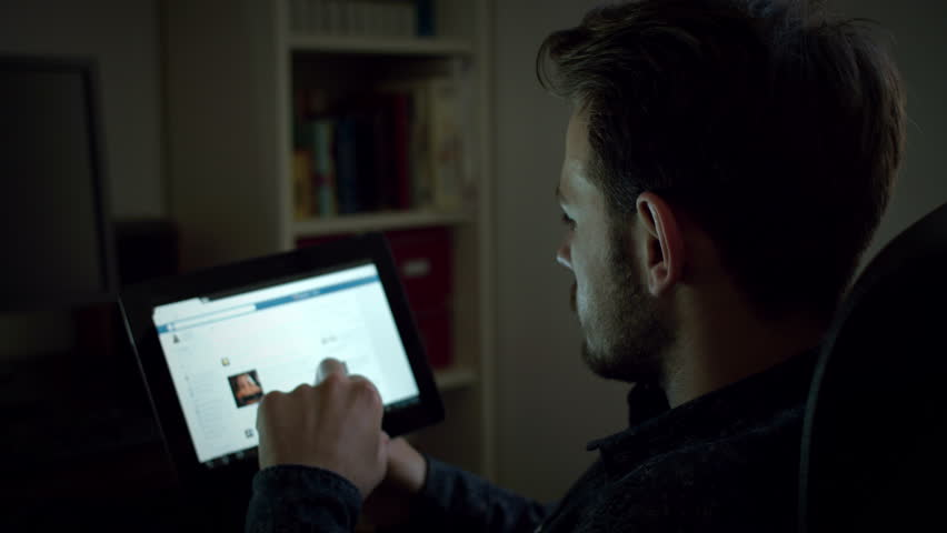 Portrait Of A Handsome Young Man Using Digital Tablet At Night Home 4k