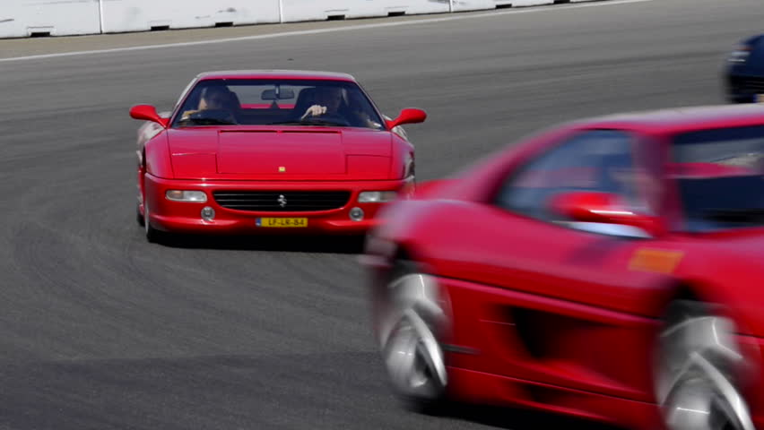 ZANDVOORT, THE NETHERLANDS - JUNE 29: Various Ferrari sports cars on track during the Italia a Zandvoort event at the race track. The cars are two F355, 599 GTB, 360 Modena Spider and 458 Italia