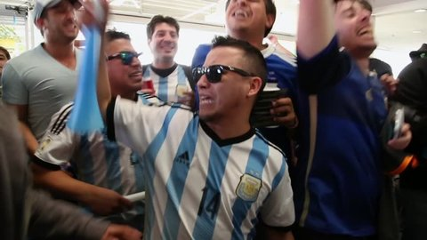 """SAO PAULO, BRAZIL - CIRCA JULY: Argentina fans sing """"Brasil, decime que se siente"""" before the mach Argentina x Netherlands in 2014 World Cup"""