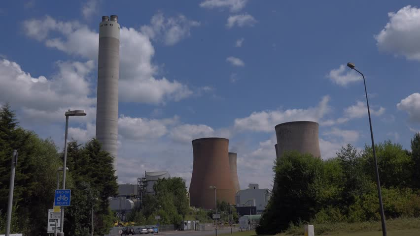 RUGELEY, STAFFORDSHIRE, ENGLAND. JULY 2014:Cooling Towers of Coal Powered Electricity Power Generating Station - 4k Industrial Buildings Background