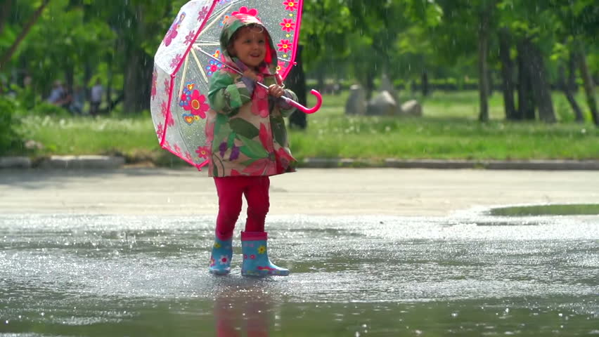 Girl having the time of her life in the downpour