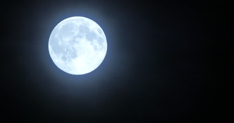 Close-up Of A Super Moon With Mystical Clouds Moving Past