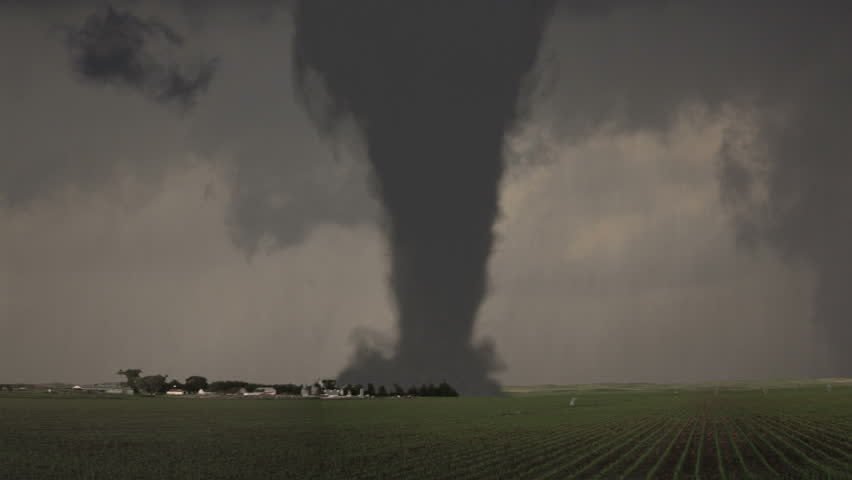 A massive tornado (CGI) cutting a path through farmland in the Midwest in UltraHD. A very detailed and realistic animation created in MAYA.