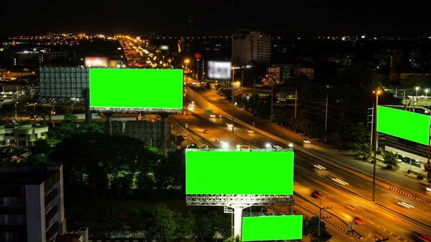 Top view of highway at night with green screen billboard (Zoom out) #6813085