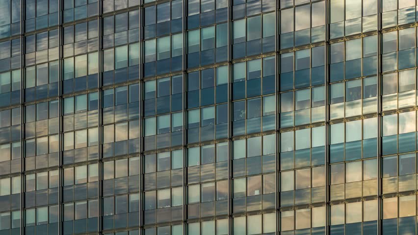 Modern Architecture Videos clouds reflection on a glass facade - modern office building