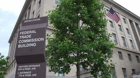 WASHINGTON, DC - MAY 2014:  FTC headquarters sign, flag.  Federal Trade Commission promotes consumer protection & elimination and prevention of anti-competitive business practices.