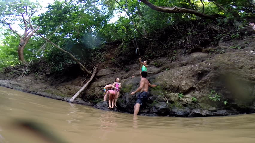 Family having fun by swimming hole   Shutterstock HD Video #6870415