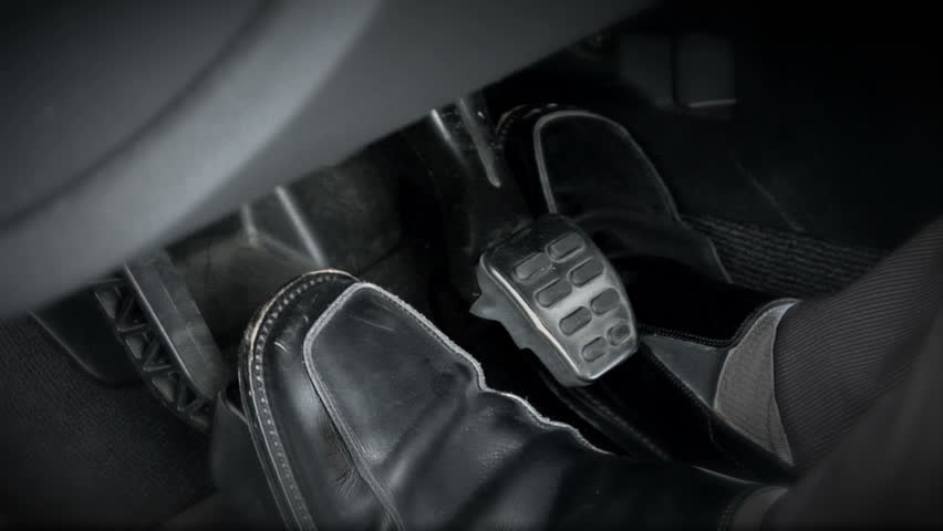 This Is A Shot Of Sports Car S Pedals The Driver Changes Feet Quickly As He Shifting Through Gears