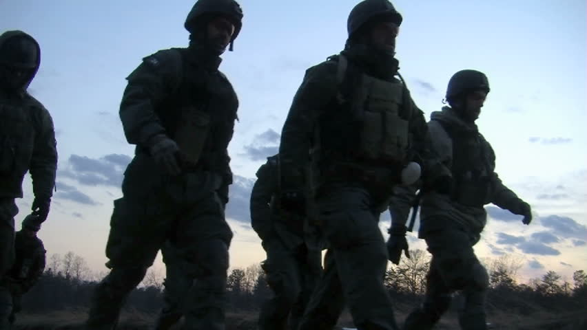 Afghanistan, Circa 2011: Special Ops Soldiers walk off range from a field in Afghanistan, Circa 2011.