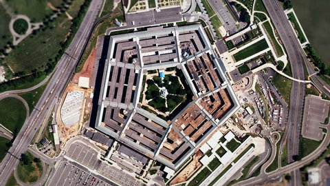 Satellite Zoom into U.S. Pentagon (24fps). A slow aerial zoom in on the United States Pentagon building in Arlington, Virginia, shot from a satellite perspective above with moving clouds and traffic.