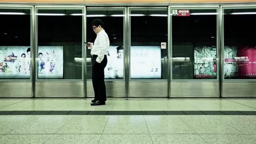 HONG KONG, CIRA 2014: People on the subway platform waiting train | Shutterstock HD Video #6993025