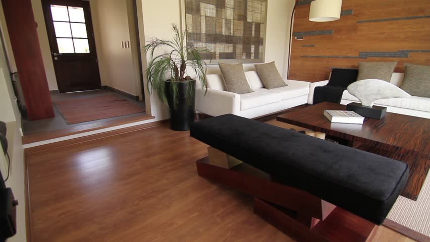 SANTIAGO, CHILE - A Living Room With Two White Sofas With Grey Cushions Are  Back Against A Wood Paneled Wall In A Showroom House. The Entrance To House  Can ...