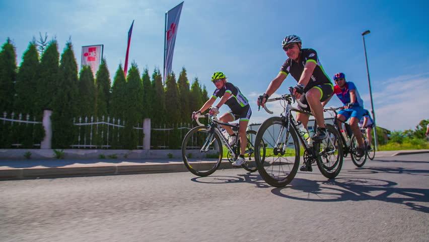 VRHNIKA, SLOVENIA - JUNE 2014: Bicycle marathon competition around Vrhnika. Slow motion shot of a group of bikers racing in marathon | Shutterstock HD Video #7042987