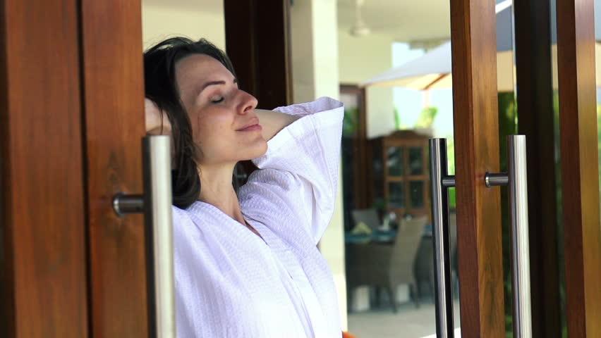 Woman in bathrobe enjoying beautiful day super slow motion 240fps - HD stock video