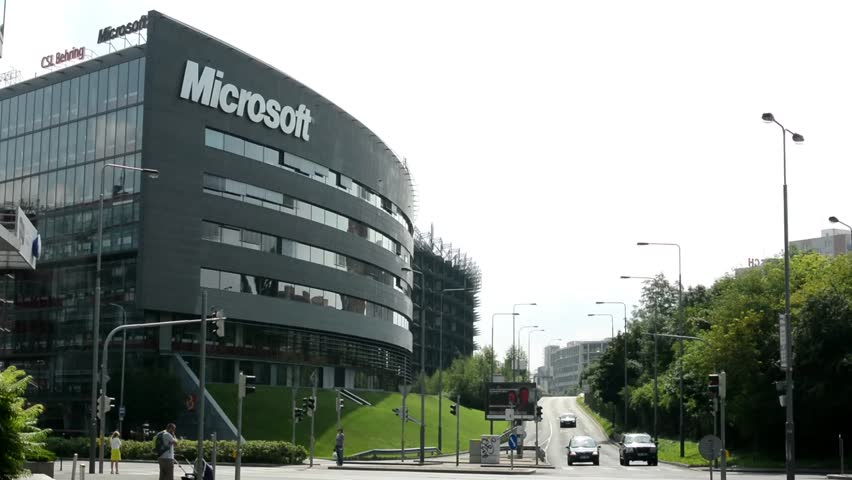 microsoft office building. PRAGUE, CZECH REPUBLIC - AUGUST 14, 2014: Microsoft Headquarters Street With Cars And People Nature (trees Grass) Other Buildings In Background Office Building