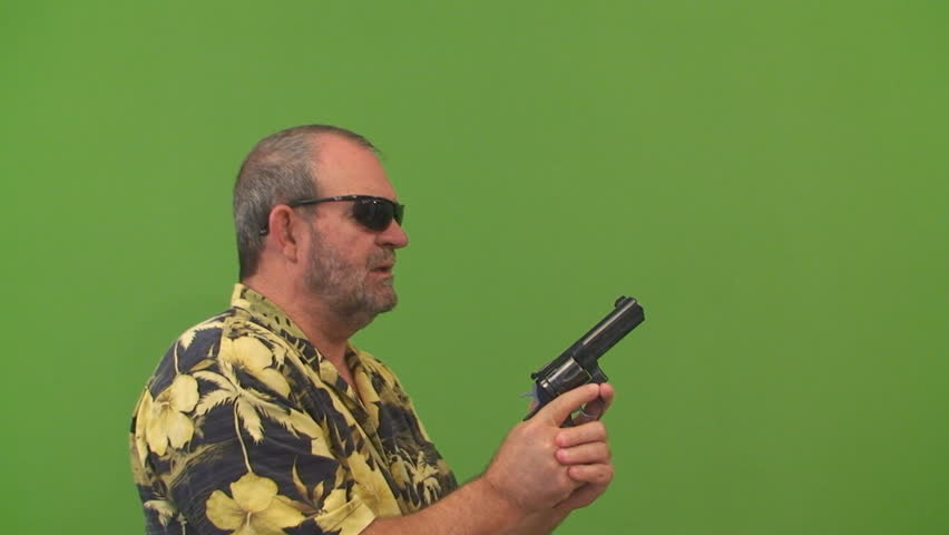 Man with a gun aiming left, right and center, Shot on a green screen