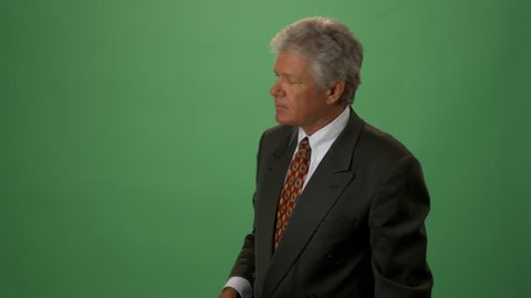 A Television Weatherman Against Green Screen.