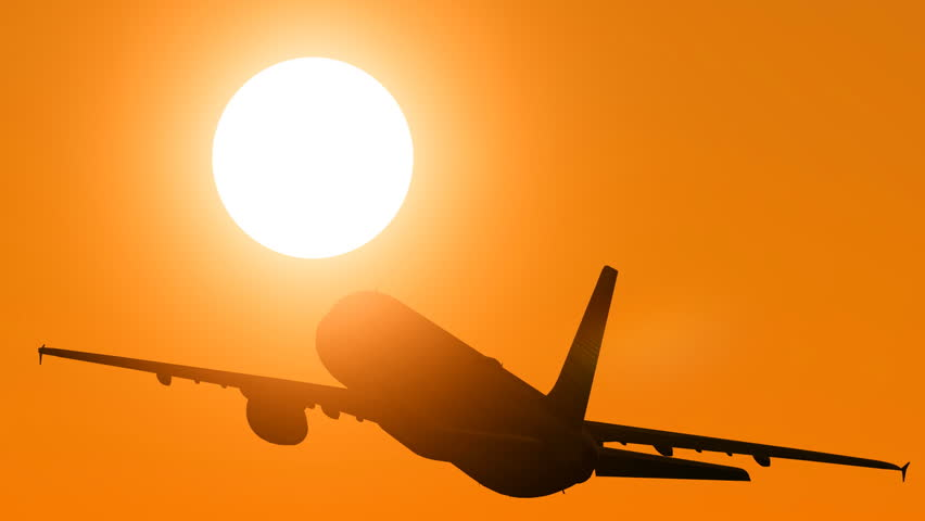 plane take off at a sunset