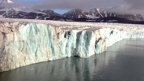 Ice calving, also known as glacier calving, is the breaking off of chunks of ice at the edge of a glacier. It is the sudden release and breaking away of a mass of ice from a glacier.