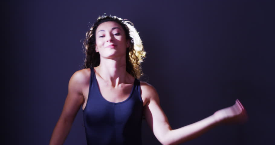 Argentinian woman dancing and flipping hair in front of light | Shutterstock HD Video #7267015