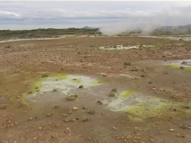 Sulfuric dioxide Gas and Steaming Geyser at Krisuvik hot springs, Iceland.