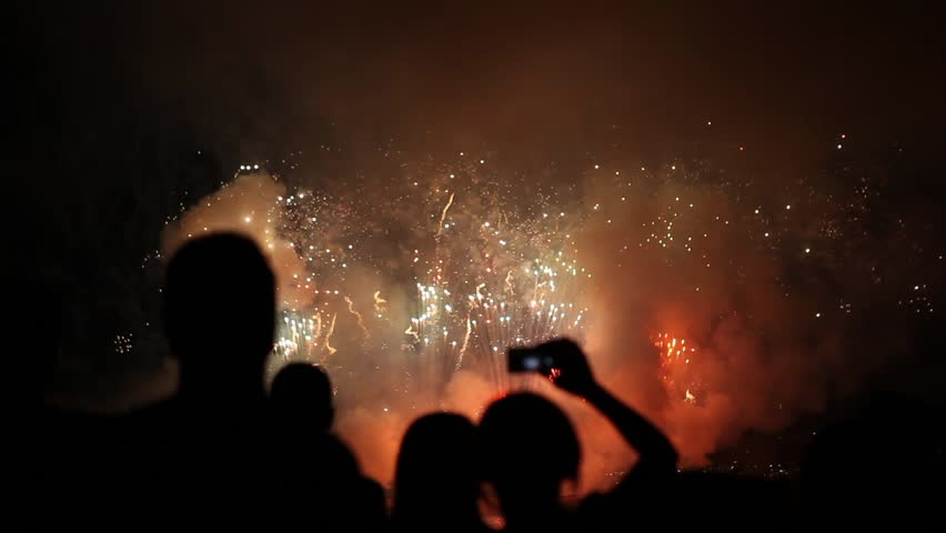 People Filming and taking pictures of Fireworks Display WITH AUDIO. Beautiful Fireworks HD. Beautiful moving particles background and glitter USA. 4th of July, New Year Celebration. Selfie | Shutterstock HD Video #7325797