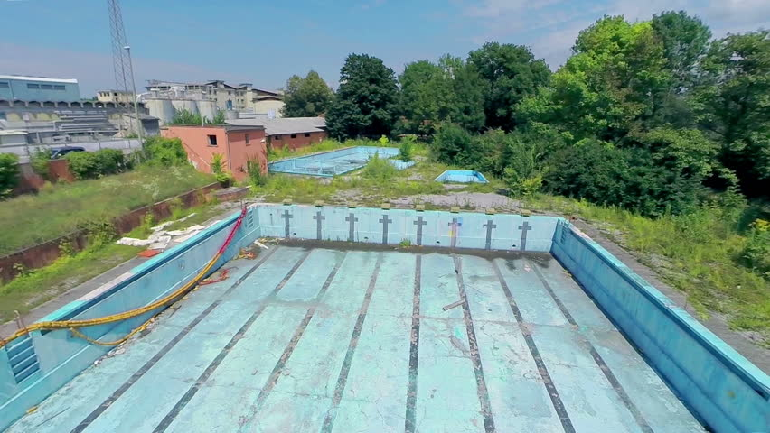 ljubljana slovenia august 2014 flying in to abandoned and empty olympic swimming pool