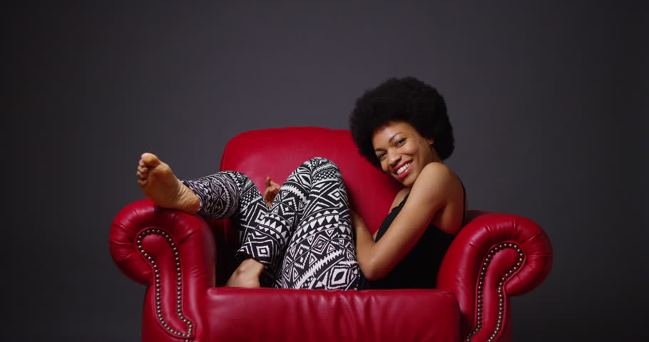 African Woman Sitting In Red Armchair Stock Footage Video