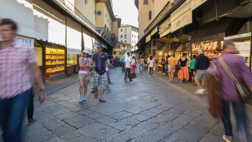 FLORENCE, ITALY - SEPTEMBER 17, 2014: People walking on Ponte Vecchio (Old Bridge). Ponte Vecchio is a medieval bridge, one of the most famous and popular tourist attractions in Florence. Time lapse.