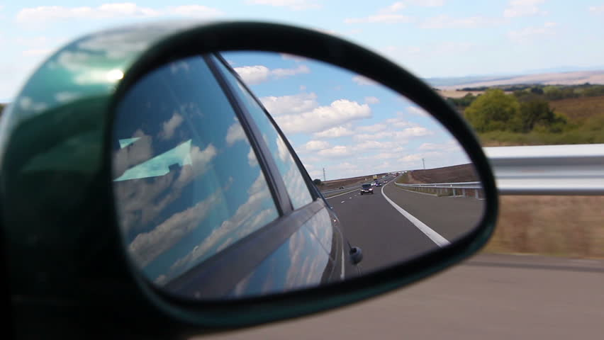 Hand Reflection View In A Rear View Mirror Of A Fast Sport