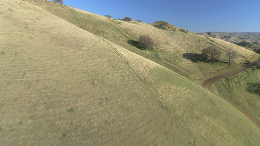 Aerial view of unspoiled green undulating hillside