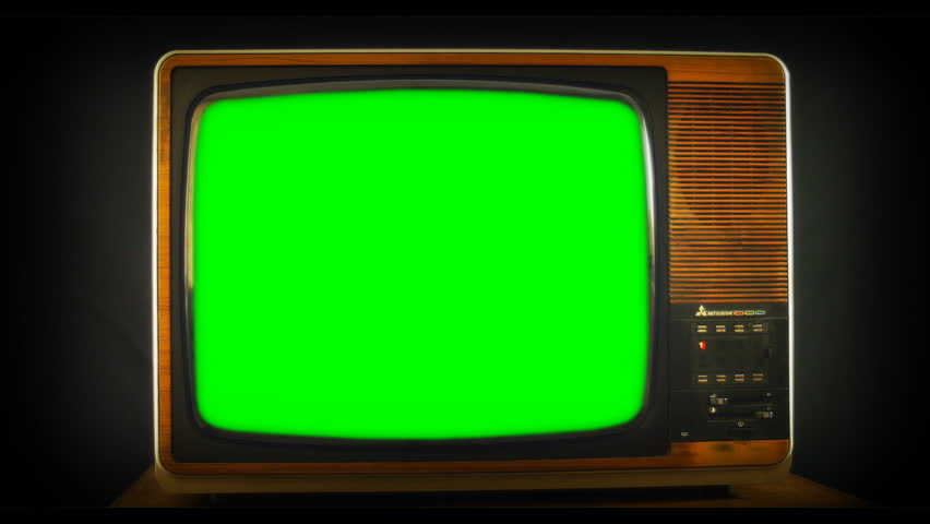 Zoom into vintage Analog TV with green screen. 76 years of television history came to an end at midnight on Wednesday 24 October 2012 when the analogue TV signal was switched off. (UK, July 2014)  | Shutterstock HD Video #7434715