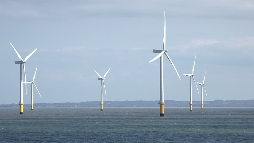 Tracking shot of wind turbines in Liverpool Bay in the Irish Sea, England, UK | Shutterstock HD Video #7441225