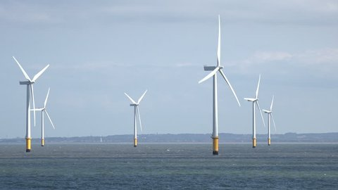 Tracking shot of wind turbines in Liverpool Bay in the Irish Sea, England, UK