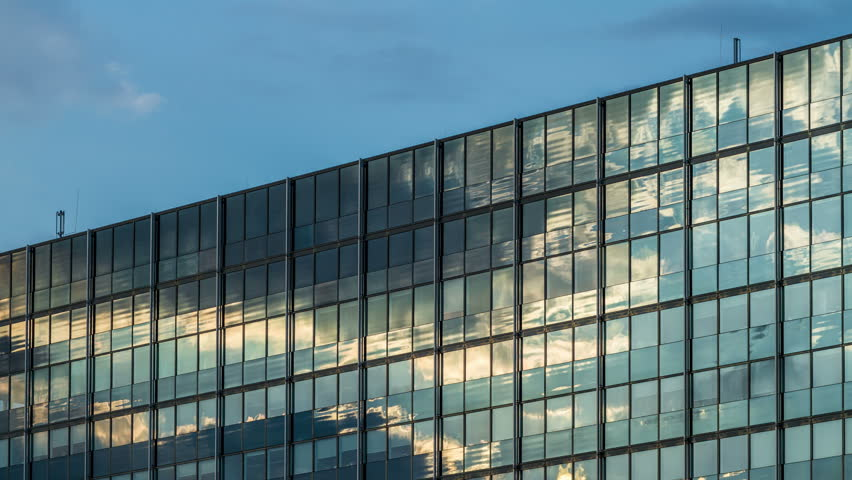 Modern Architecture Glass clouds reflection on a glass facade - modern office building
